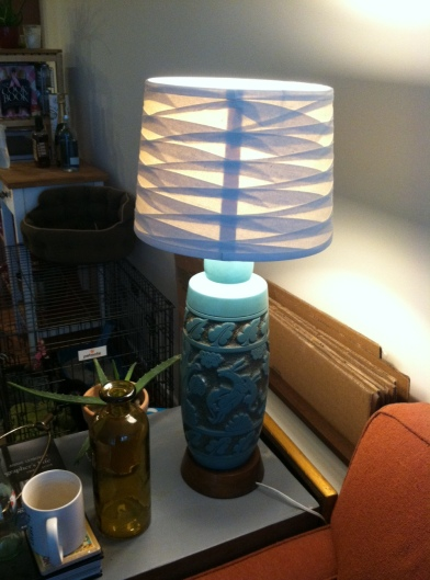 my favorite lamp from a flea market. of course I never bought a lamp shade for it. Com-pro-mise.